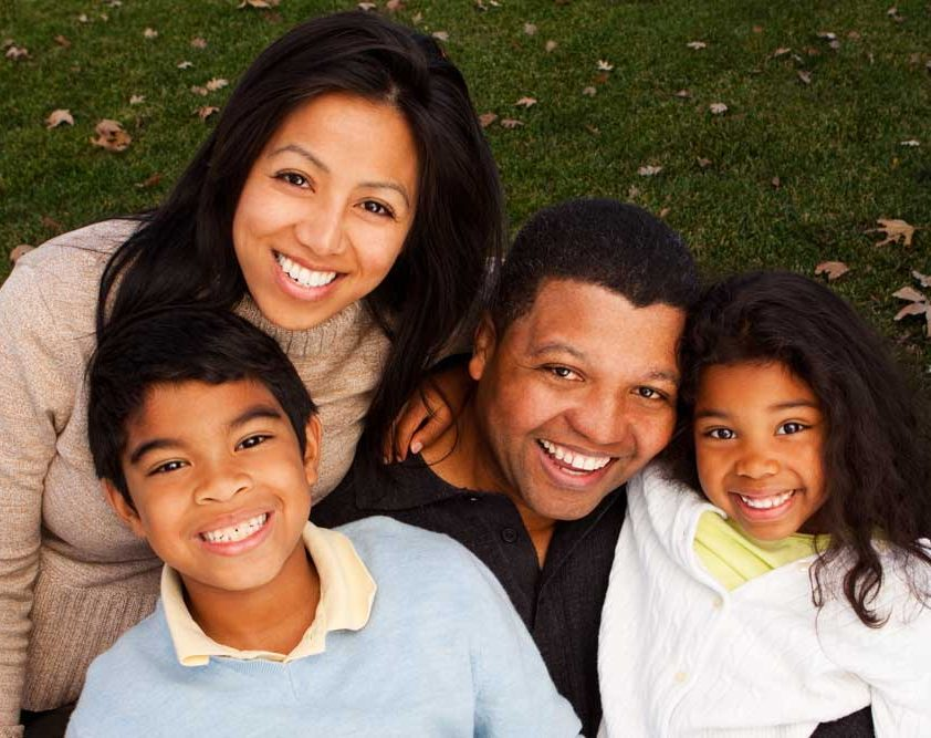 Family hugging outdoors - Critical Illness Insurance you can depend on. Face the future with confidence.